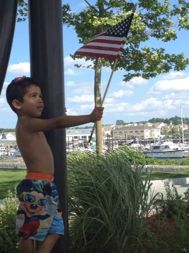 Little Manny Sileira, age 3, giving America love on the fourth of July